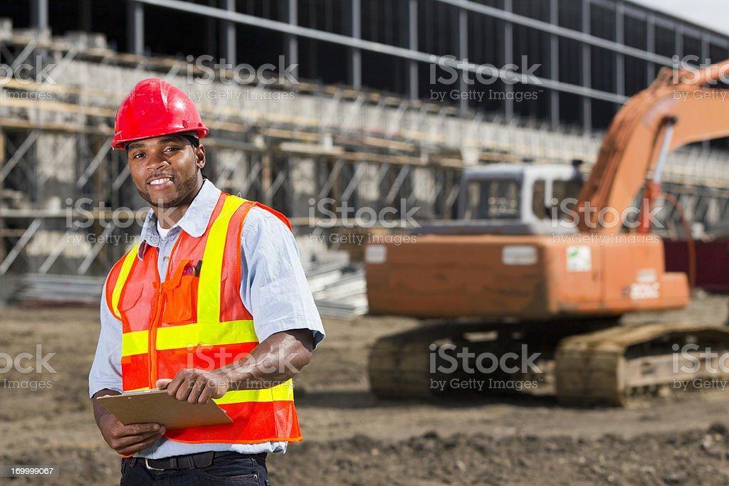 Construction Worker and Building Site royalty-free stock photo