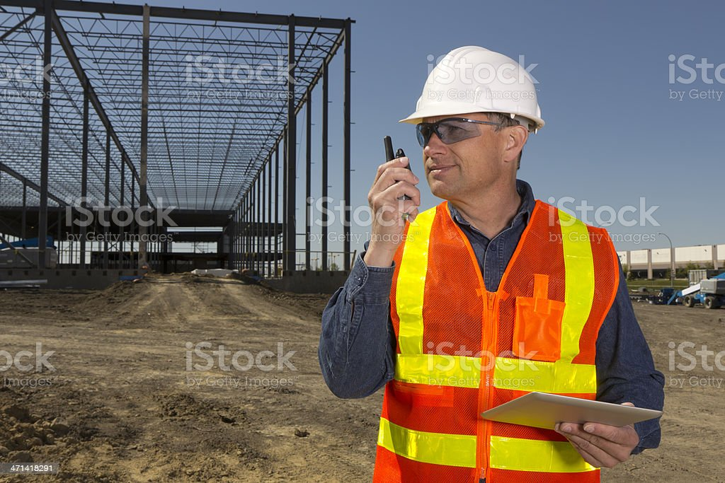 Construction Worker and Communication stock photo