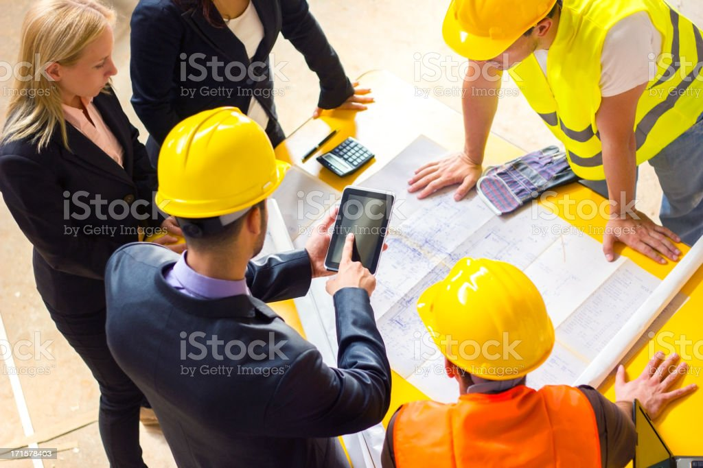 Construction worker and computer. royalty-free stock photo