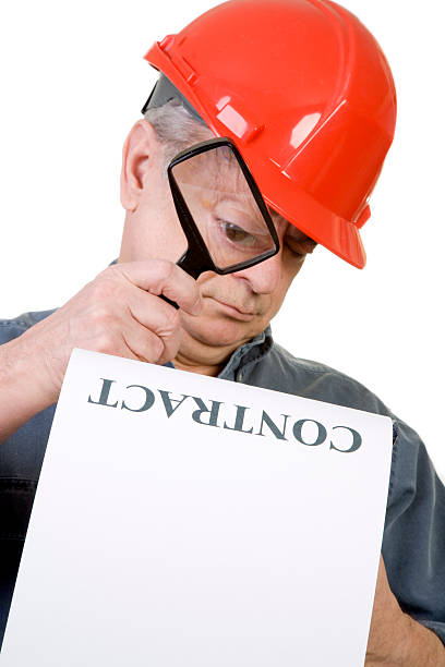 Construction Worker and Contract stock photo