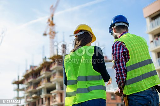 istock Construction worker and his manager checking the progress 617878058