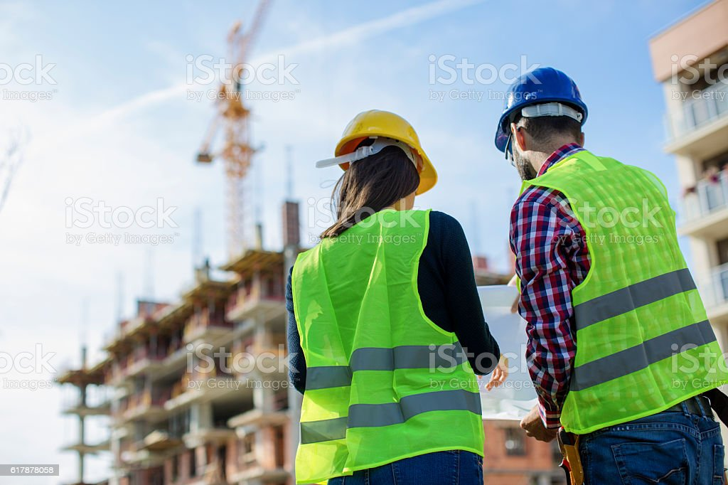 Construction worker and his manager checking the progress stock photo