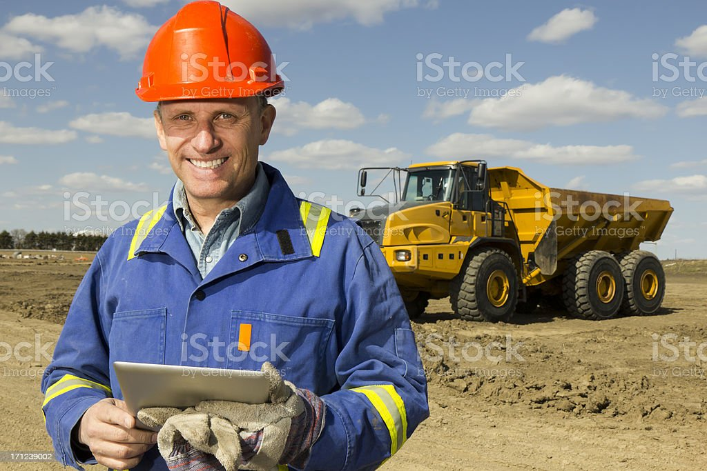 Construction Worker and PC royalty-free stock photo
