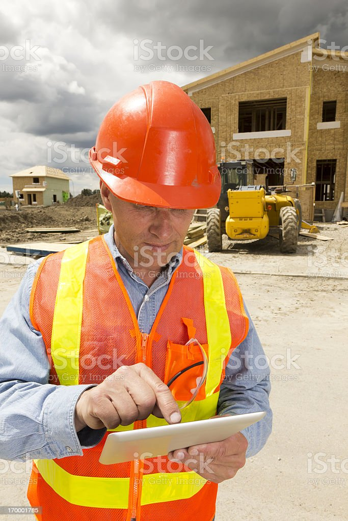 Construction Worker and Tablet PC stock photo
