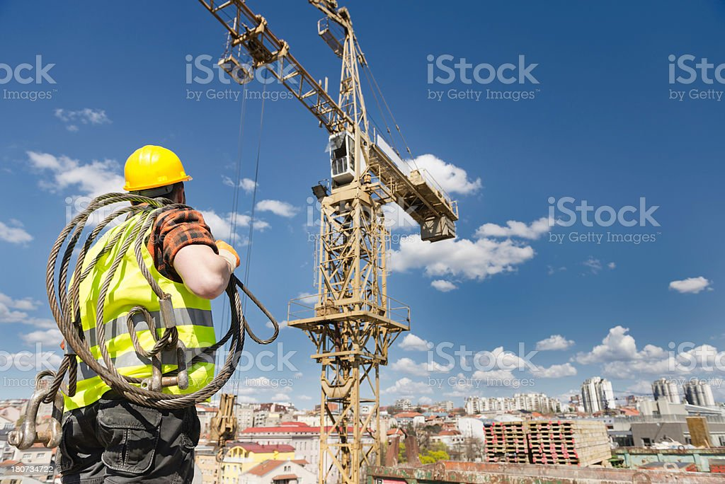 Construction worker and the tower crane stock photo