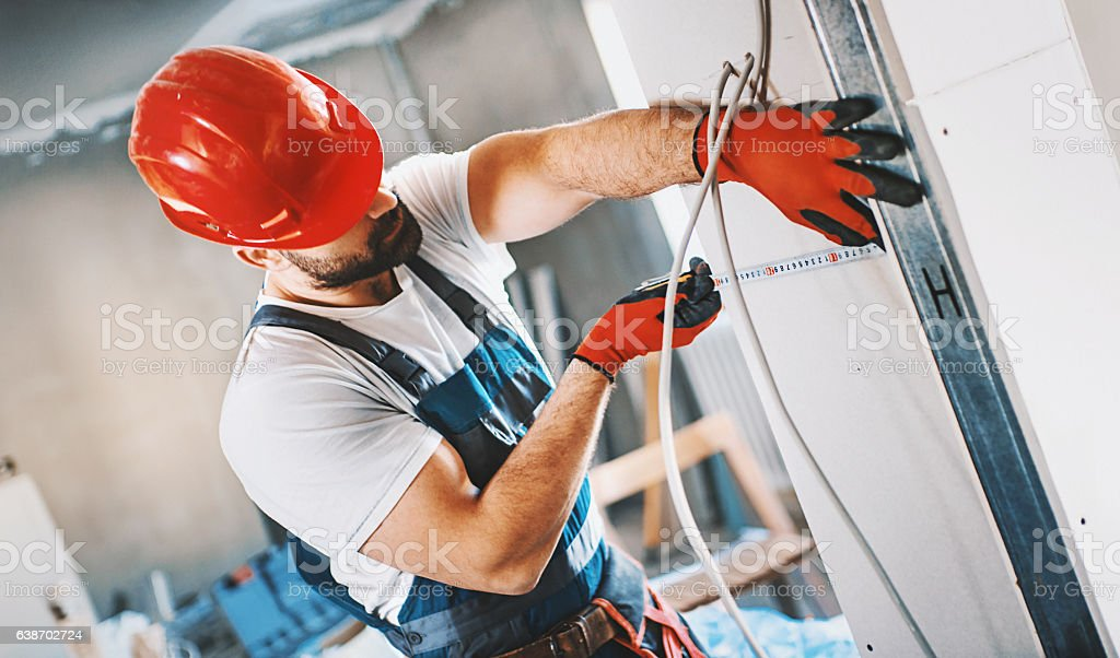 Construction worker assembling plaster column. stock photo