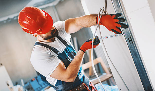 construction worker assembling plaster column. - pillar drill stock photos and pictures