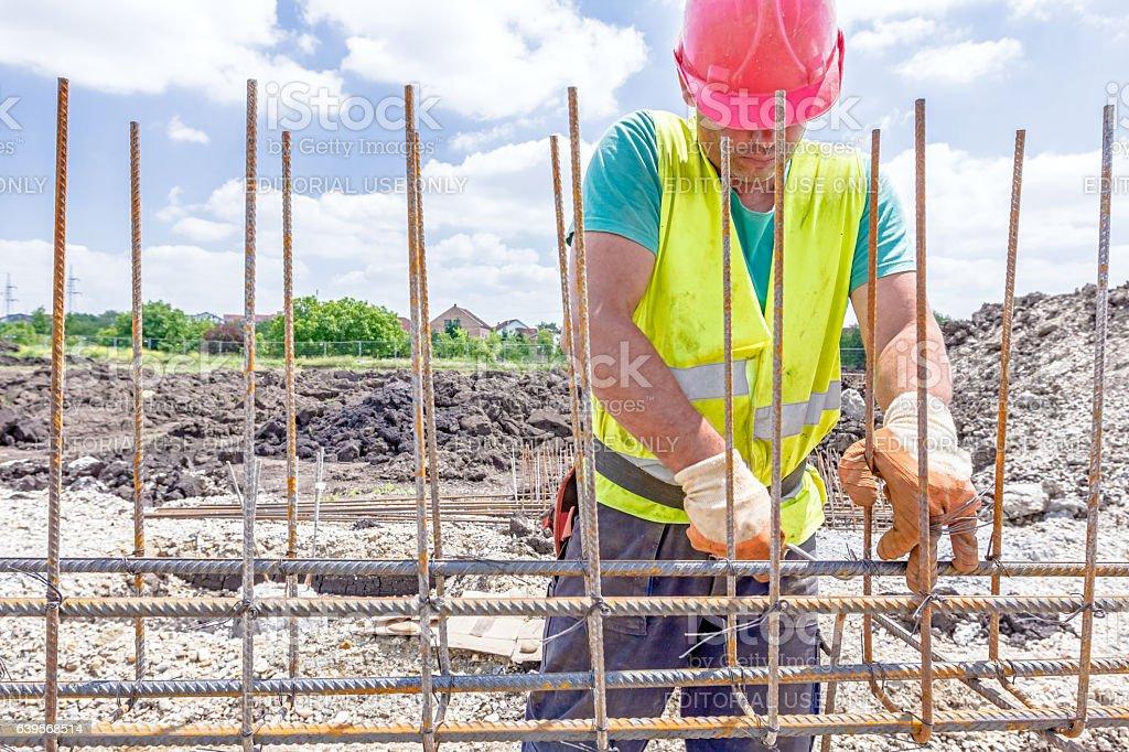 construction worker binding rebar for reinforce concrete column royalty free stock photo