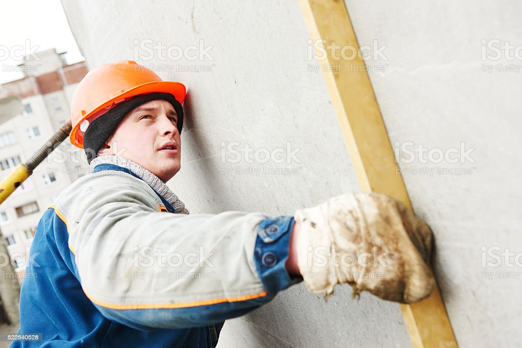 Construction worker. Builder concreter with level stock photo