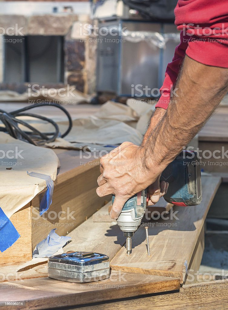 Construction Worker Building a Redwood Deck royalty-free stock photo