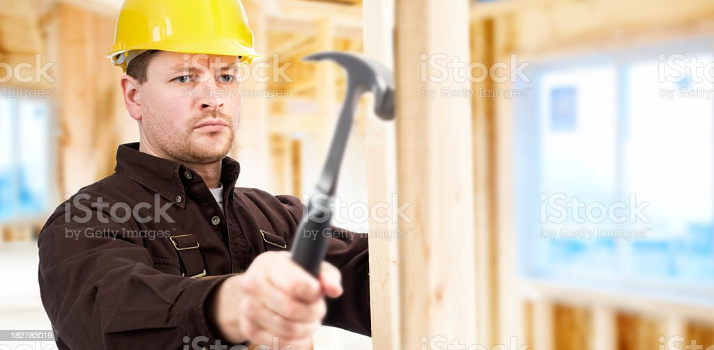 Construction worker building home royalty-free stock photo