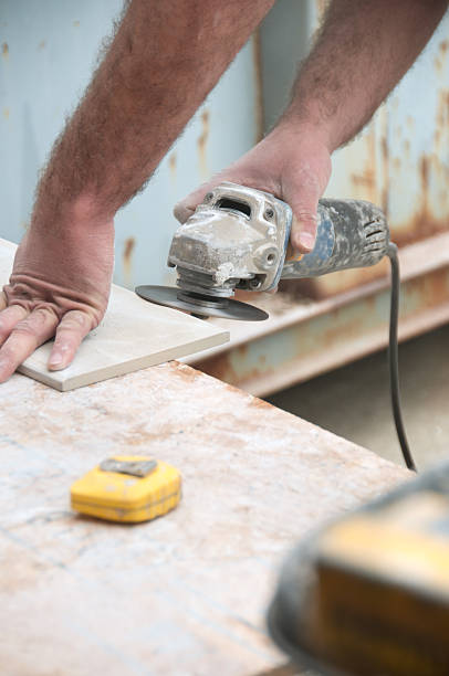 construction worker bullnosing a tile - dremel wood stock photos and pictures