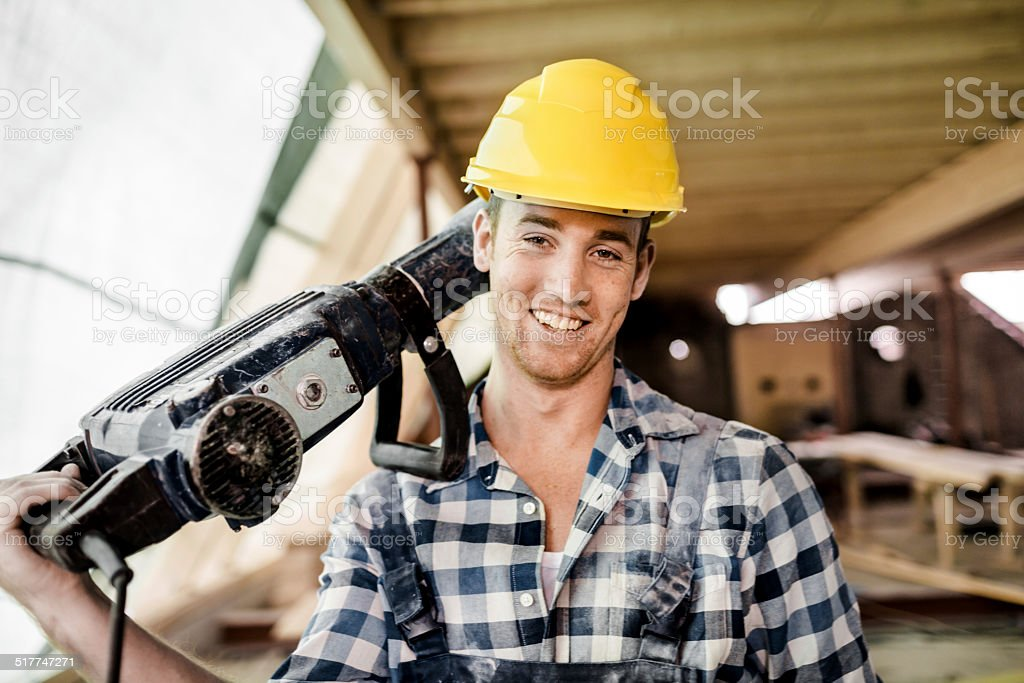 Construction Worker Carrying Jackhammer stock photo