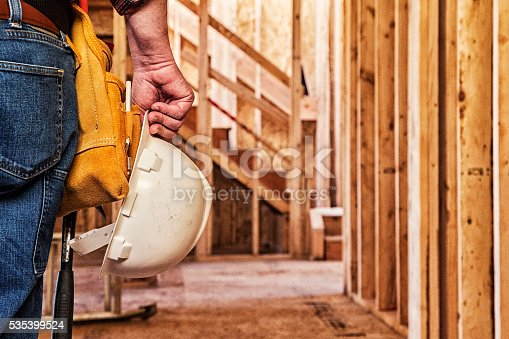istock Construction Worker Closeup with Hardhat in Hand 535399524