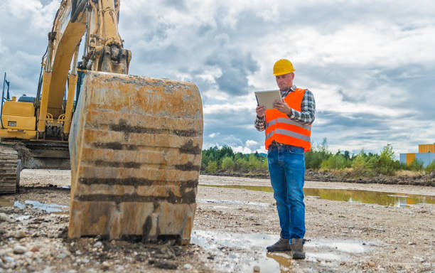Construction Worker Contractor Using Tablet Computer stock photo
