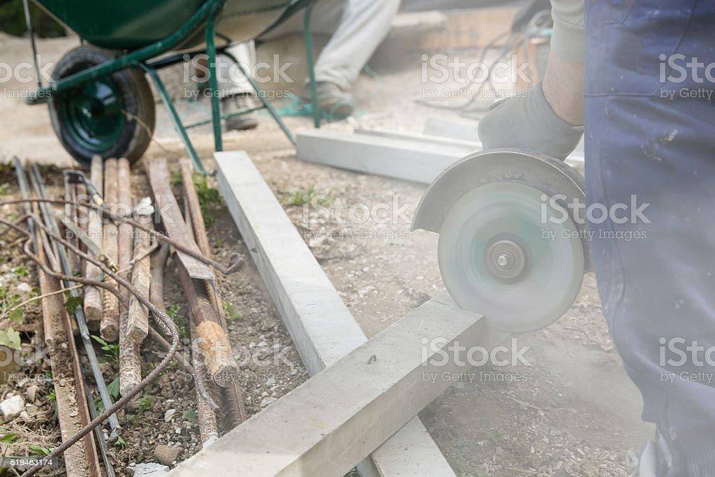 Construction worker cutting a reinforced concrete pillar stock photo