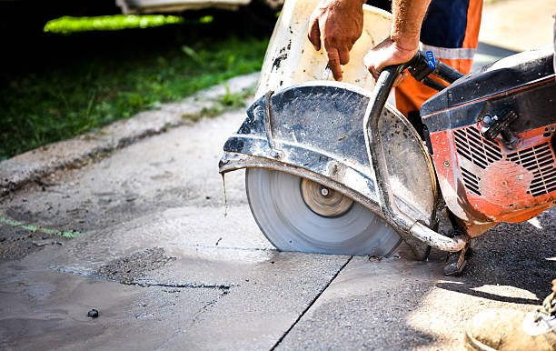 construction worker cutting asphalt paving for sidewalk - cutter stock pictures, royalty-free photos & images