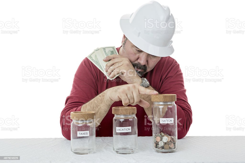 Construction worker decides over the use of money stock photo