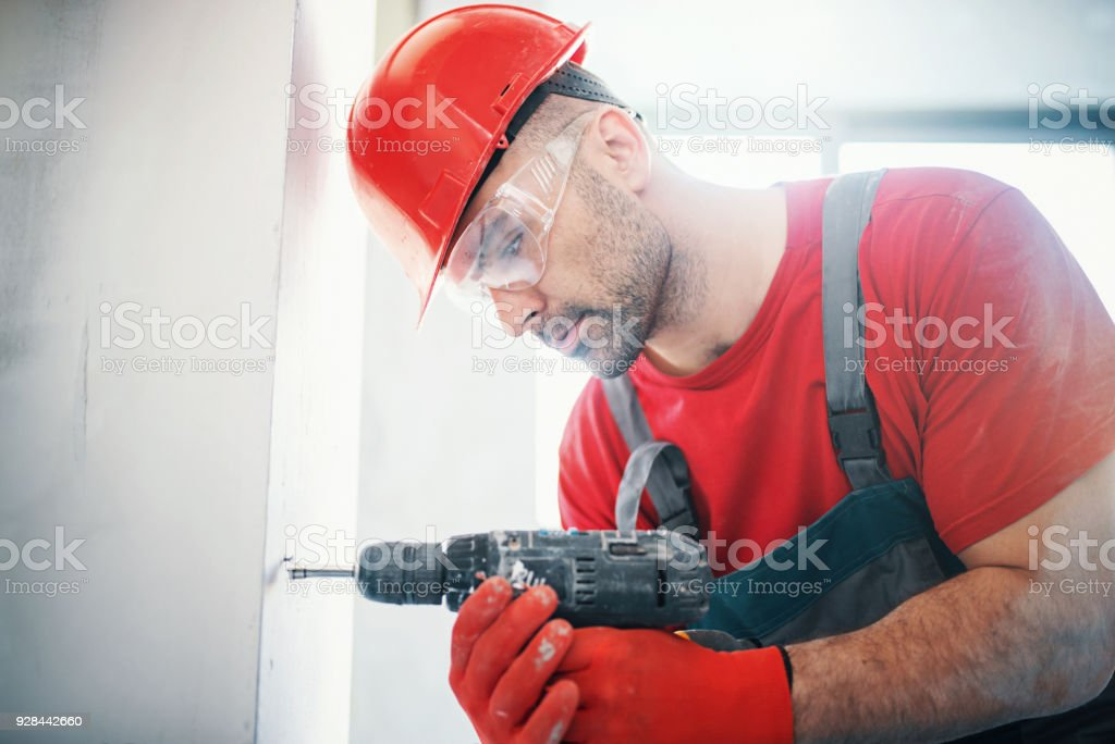 Construction worker during interior decoration. stock photo