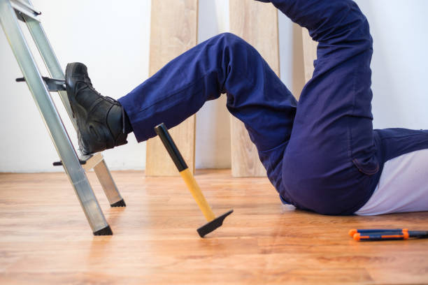 Construction worker falling down the ladder On the job injury of one worker just fallen from a ladder misfortune stock pictures, royalty-free photos & images