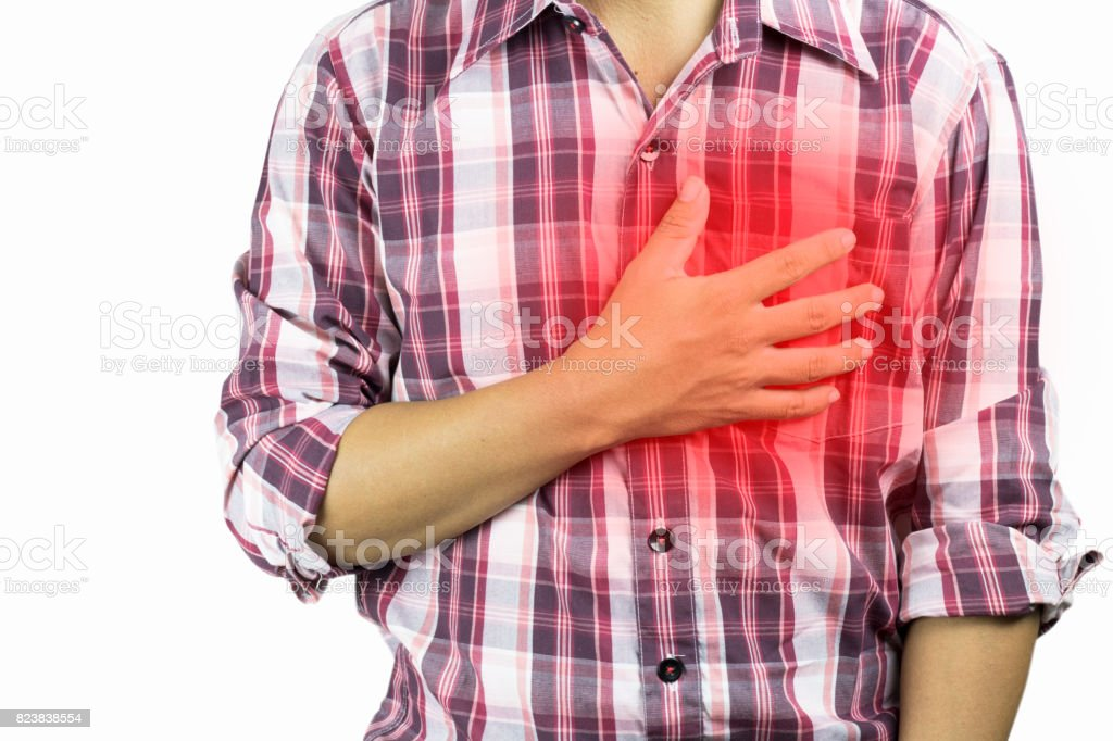 construction worker has suffering from chest pain, severe heart ache, attack  on white background, concept as healtcare,  disease and save stock photo