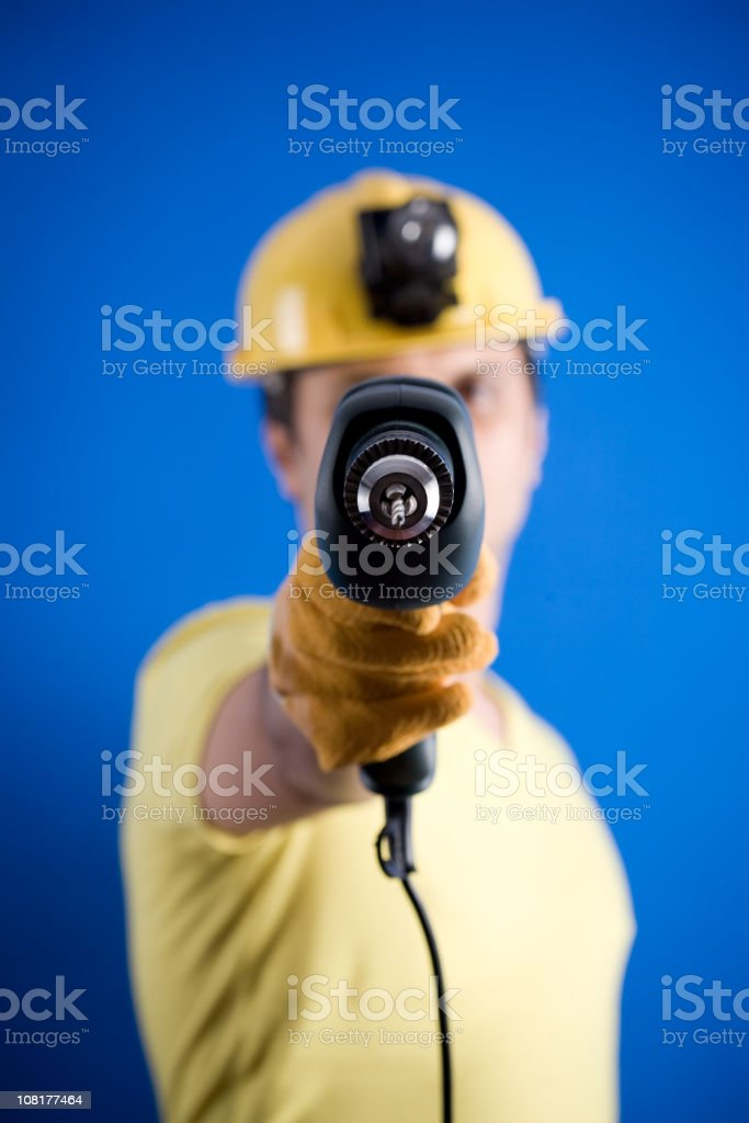 Construction Worker Holding Drill stock photo