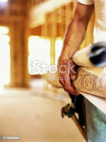 istock Construction worker holding hammer. 474866586