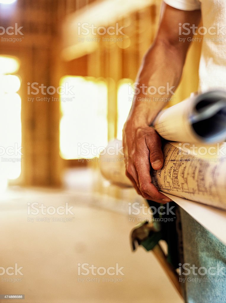 Construction worker holding hammer. stock photo