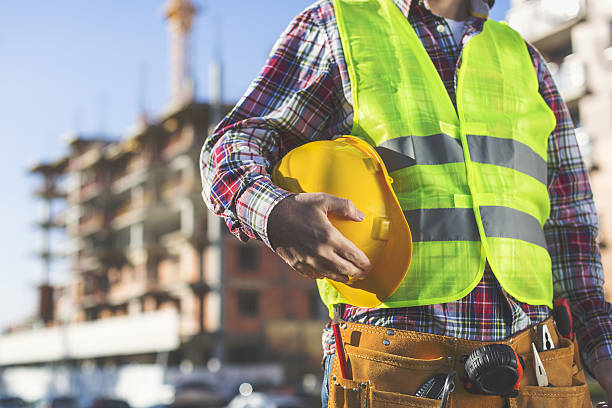 Construction Worker  holding helmet stock photo