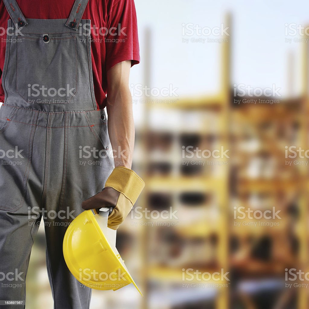 A construction worker holding his hard hat royalty-free stock photo