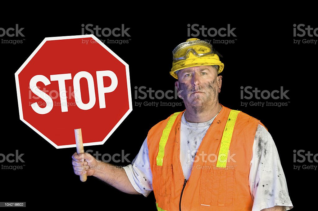 Construction worker holding stop sign royalty-free stock photo