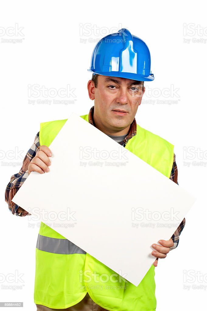 Construction worker holding the blank poster royalty-free stock photo