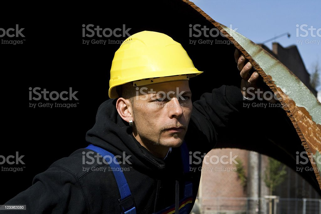construction worker in a metal tube royalty-free stock photo