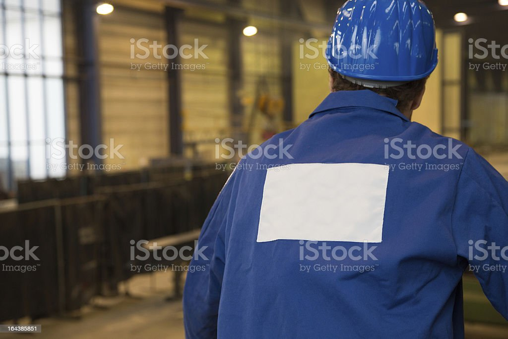 Construction worker in assembly hall royalty-free stock photo