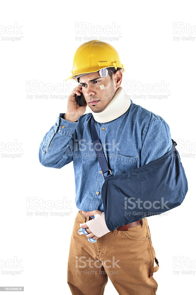 Construction worker injured and on the phone royalty-free stock photo
