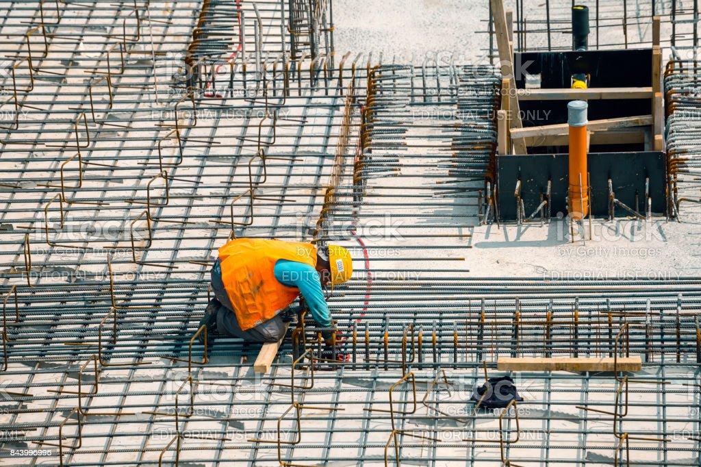 Construction worker install rebar stock photo