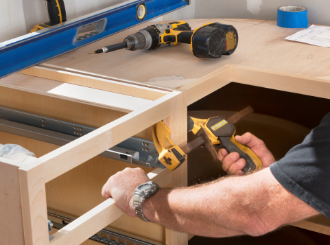 Construction Worker Installing Kitchen Cabinets Stock ...