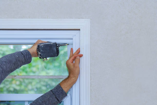 Construction worker installing window in house Construction worker installing window in a new house replacement stock pictures, royalty-free photos & images
