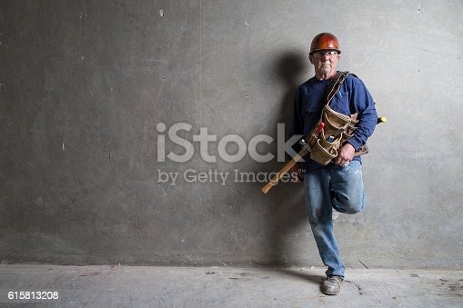 istock Construction Worker Leaning Against Wall 615813208