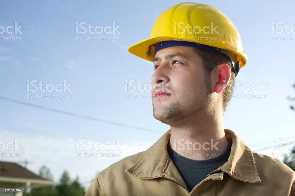A construction worker looking out into the distance  stock photo