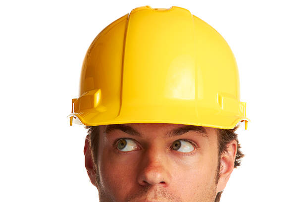 construction worker looking worried stock photo