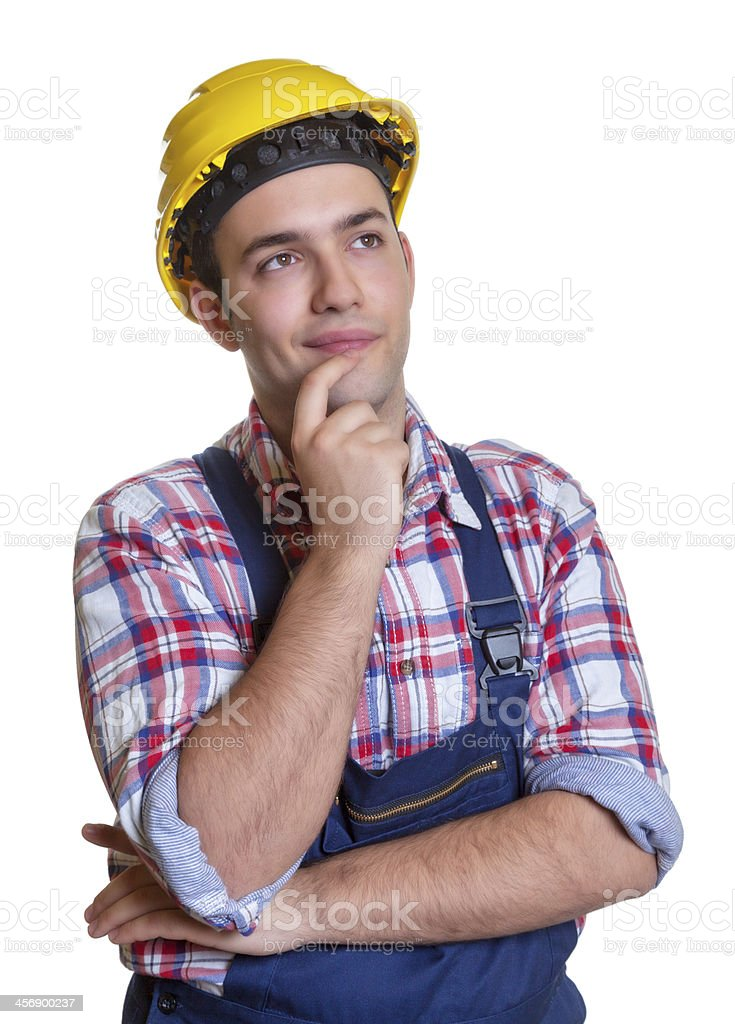 Construction worker making plans for the future stock photo