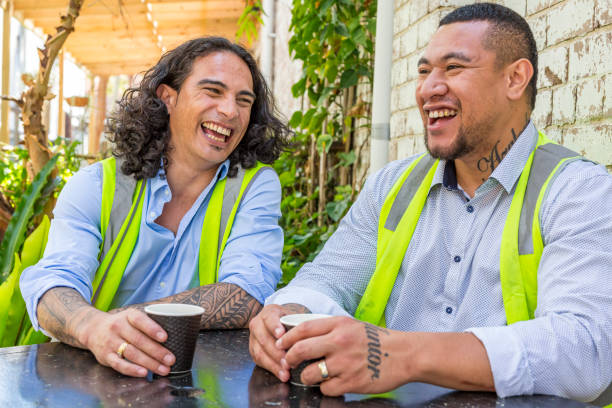 construction worker men in high vis vests having a coffee break - maori stock photos and pictures