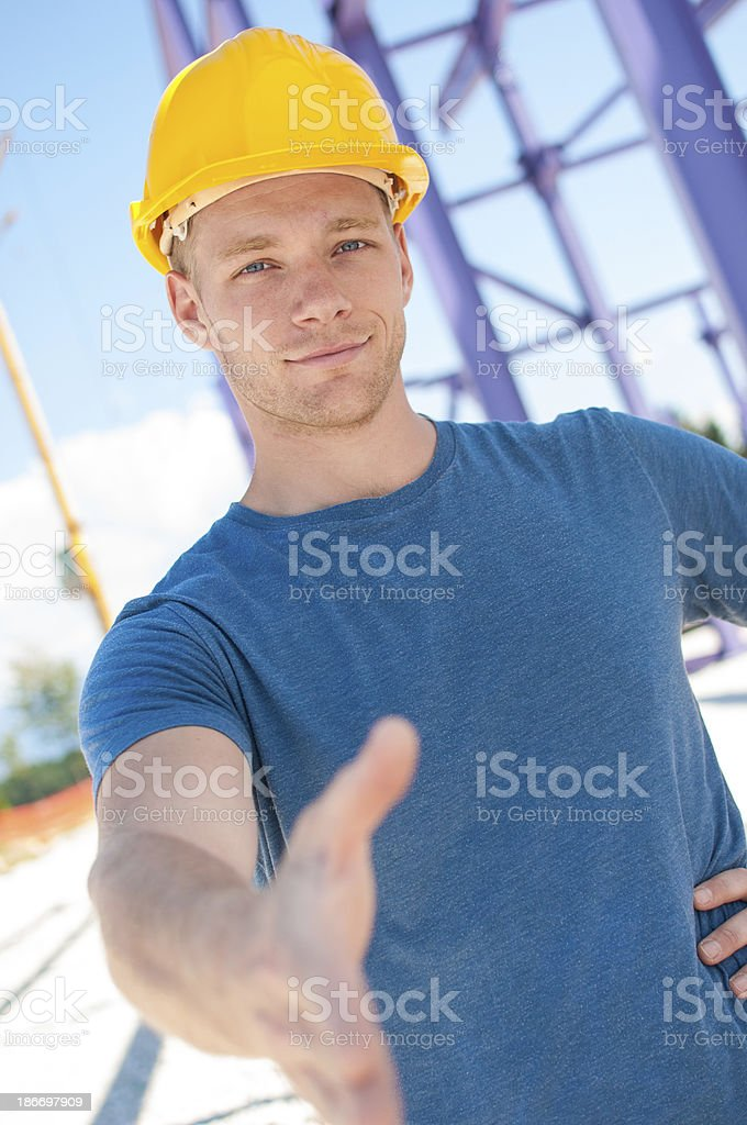 Construction worker offering handshake royalty-free stock photo