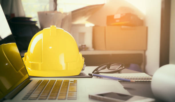 Construction worker office desk with laptop computer. stock photo
