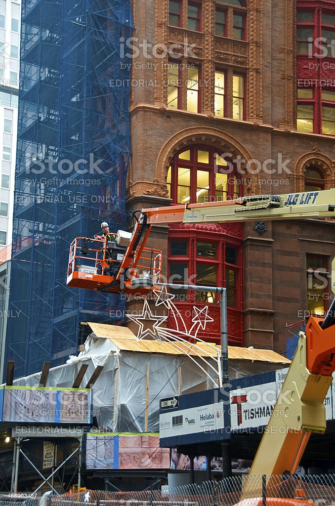 Construction worker on a lift platform, Lower Manhattan, NYC royalty-free stock photo