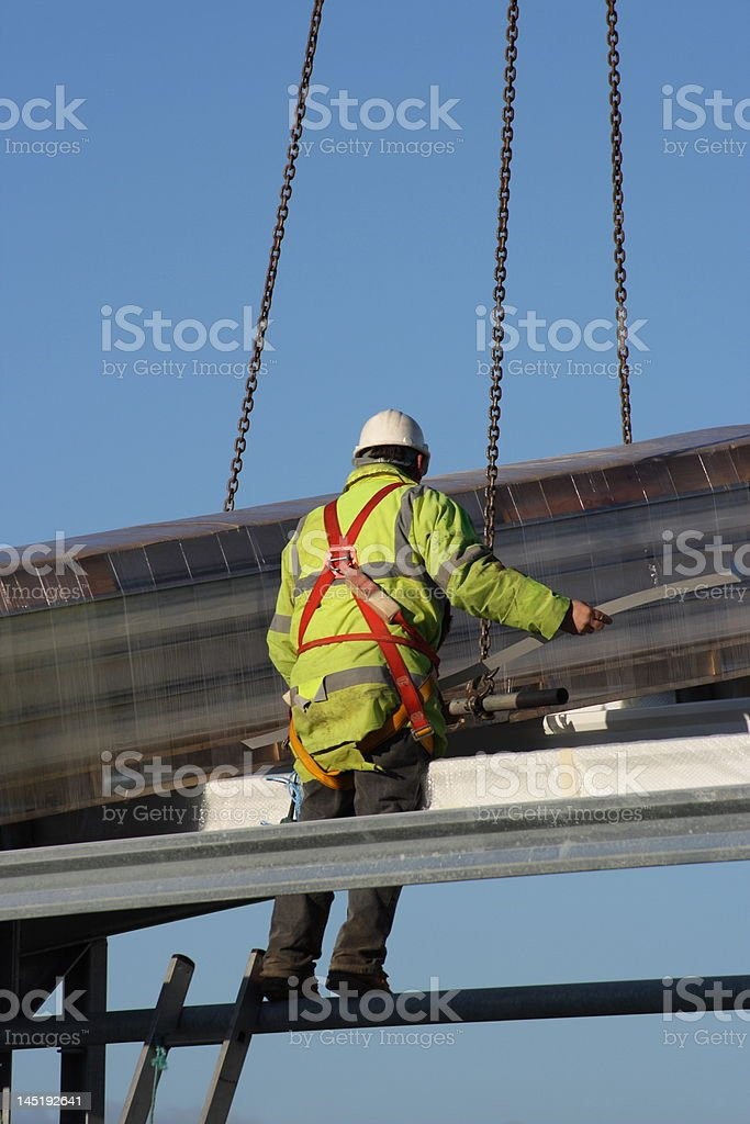 Construction worker on a roof. stock photo