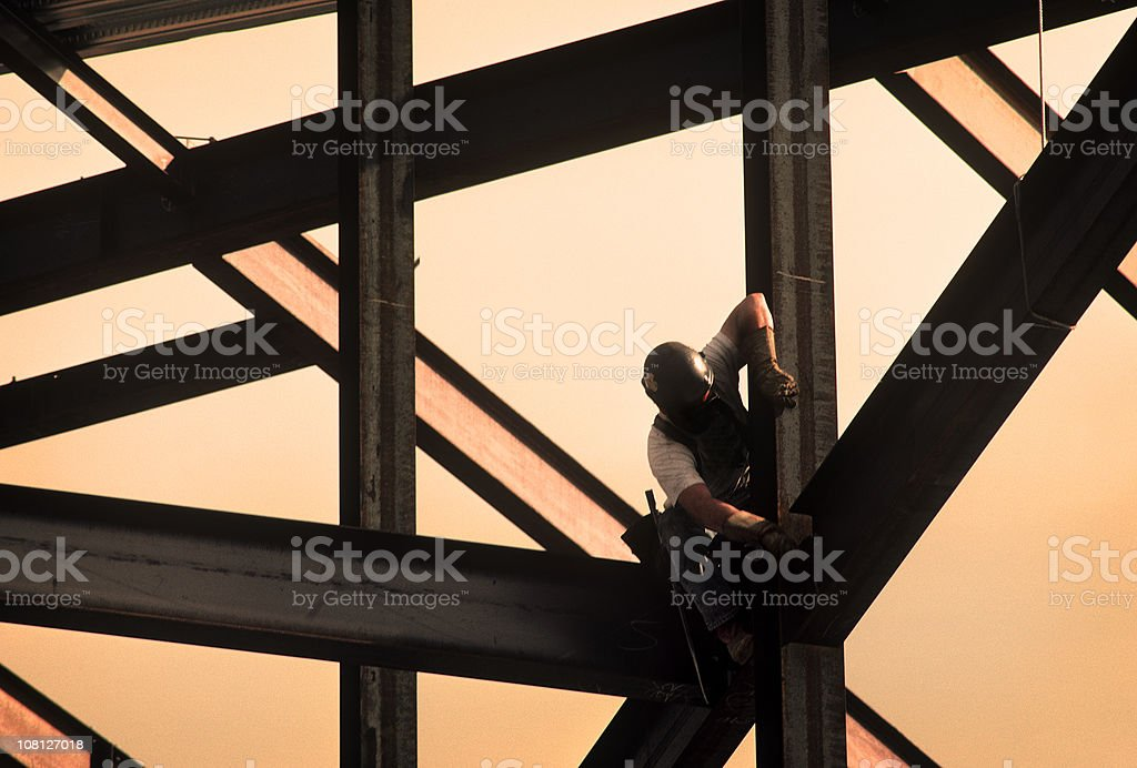 Construction Worker on High Rise Frame of Building stock photo