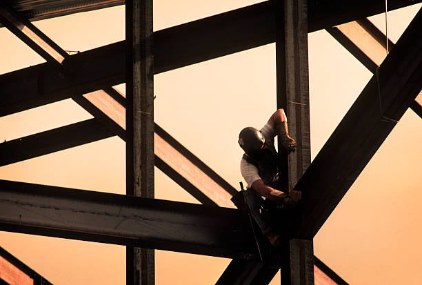 Construction Worker on High Rise Frame of Building  girder stock pictures, royalty-free photos & images