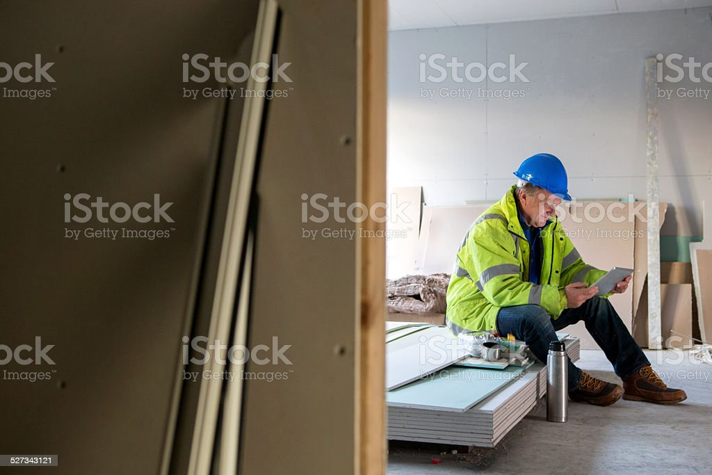 Construction Worker On His Dinner Break stock photo